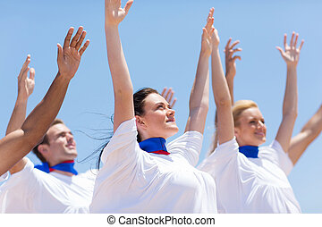 Christian chruch choir praising outdoors - group of...