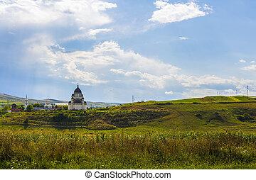Christian church in a field in Romania