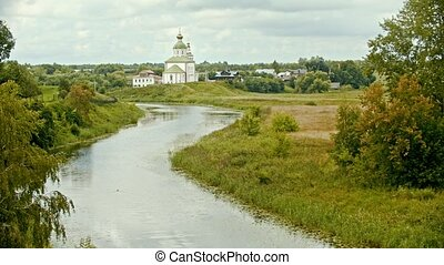 Christian church in the village - river on a foreground -...