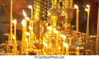 Christian church pray to god. Candle for the repose of the soul