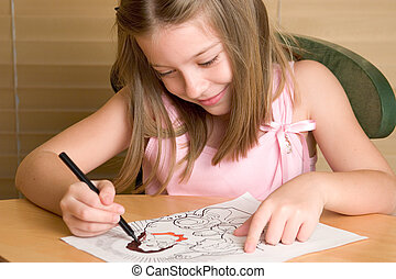Christian Coloring B - A young girl coloring in a Christian...