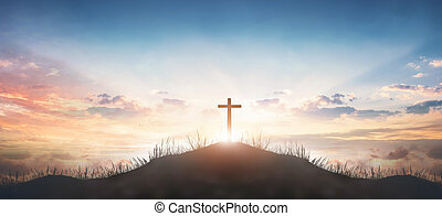 Christian concept: Silhouette cross on  mountain sunset background