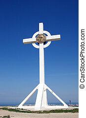 Christian cross against the blue sky