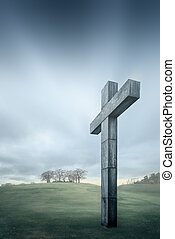 Christian cross against the sky and rolling hills