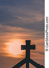 christian cross at the sunset