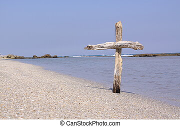 Christian Cross Beach - A wooden cross in the sand at the...