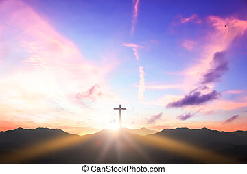 Christian cross concept: Silhouette cross on  mountain sunset background