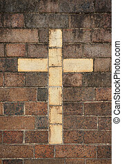 christian cross in brick wall