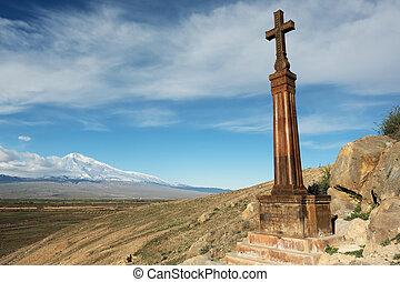 Christian cross near ancient monastery Khor Virap -...