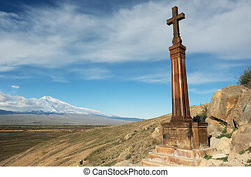 Christian cross near ancient monastery Khor Virap -...