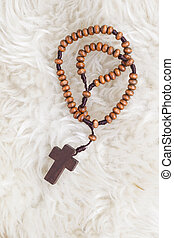 Christian cross necklace on sheep wool, Jesus religion concept a