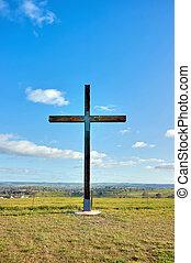 christian cross of christ in field