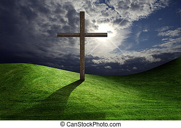 Christian cross of christ in field