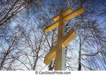 Christian cross on blue
