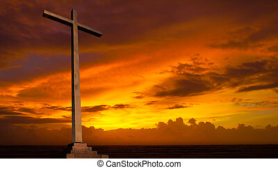 Christian cross on sunset sky. Religion background.