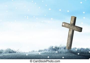 Christian cross on the grass