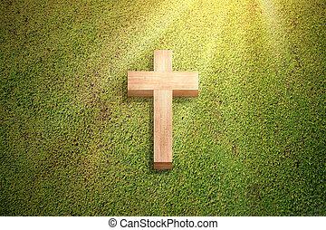 Christian cross on the green grass
