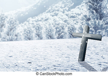 Christian cross on the snow