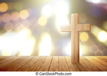 Christian cross on the wooden floor