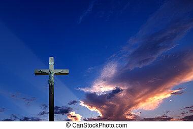 Christian cross over beautiful sunset background