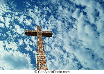 Christian Cross over bright sky