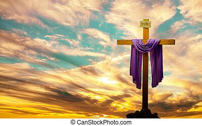 Christian cross over bright sunset background