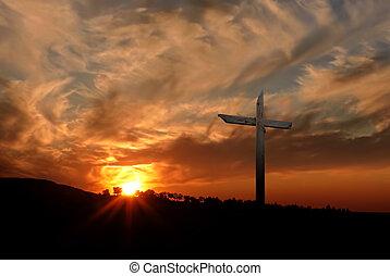 Christian cross over sunset background