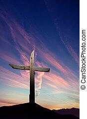 Christian cross over sunset background vertical image