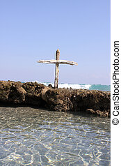Christian Cross Reef - A wooden cross out on a reef in the...