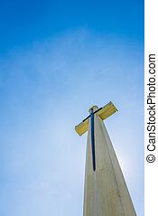 Christian cross with blue clear sky