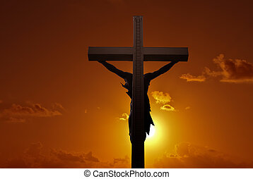 Christian cross with Jesus Christ over sunset