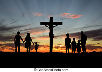 Families walking toward the Cross over sunset background