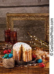 Christian holidays photos of Easter food in a rustic style. The table is covered with Easter cakes and painted eggs.