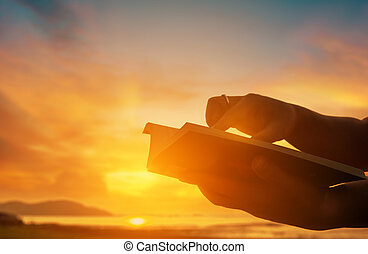 Christian praise on hill thanksgiving day background. Christian man or woman hands holding and reading a bible holy. Hands folded in prayer. worship god with christian concept religion.