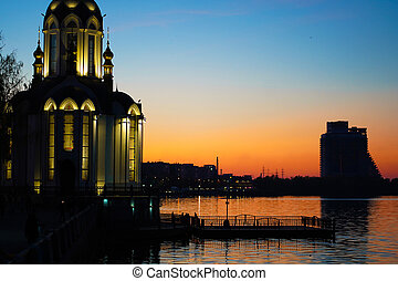 Christian temple by the water at sunset