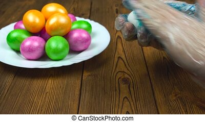 Christian tradition of coloring hard-boiled eggs during a...