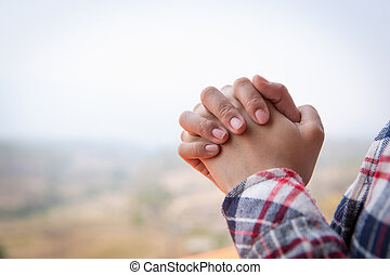 Christian woman hands praying to god on the mountain background with morning sunrise. Woman Pray for god blessing to wishing have a better life. Christian life crisis prayer to god.