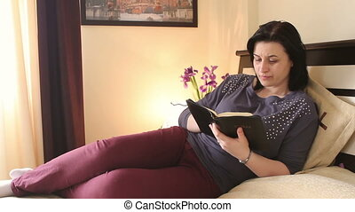 Christian woman reading Holy Bible