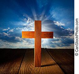 Christian wood cross on blue sky wooden