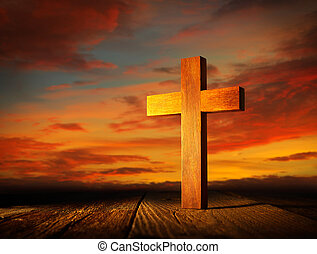 Christian wood cross on sunset sky
