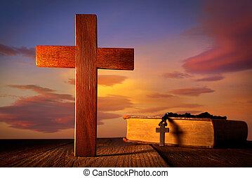 Christian wood cross on sunset sky