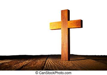 Christian wood cross on white background
