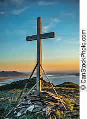 Christian wooden cross on hill