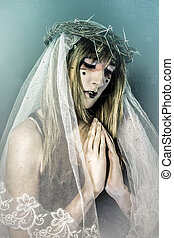 Christianity, aith concept, woman dressed in white veil and crown of thorns, virgin
