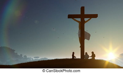 Christians praying at Jesus cross at sunset