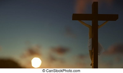 Christians praying at Jesus cross, blurry sunrise