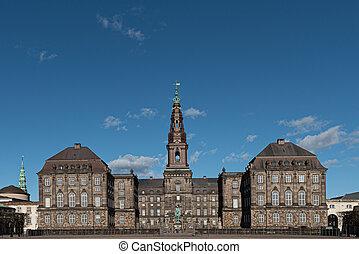 Christiansborg Palace under a blue sky on a sunny day