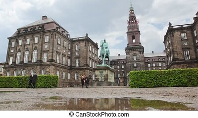 Christiansborg Slot with monument of person on horse -...