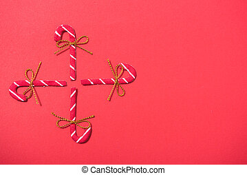 Christmas 4 candies candy cane on red background
