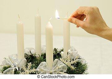 Christmas advent wreath - hand lights candle